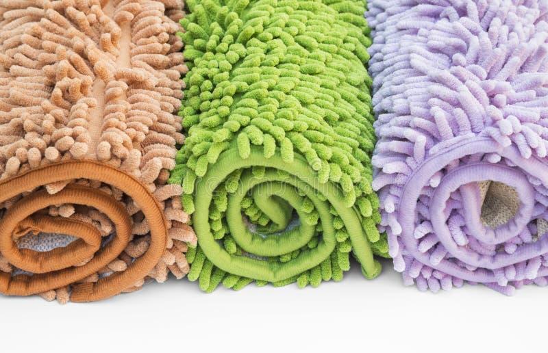 Schoonmakend voetendeurmat of tapijt voor schoon uw voeten royalty-vrije stock afbeelding