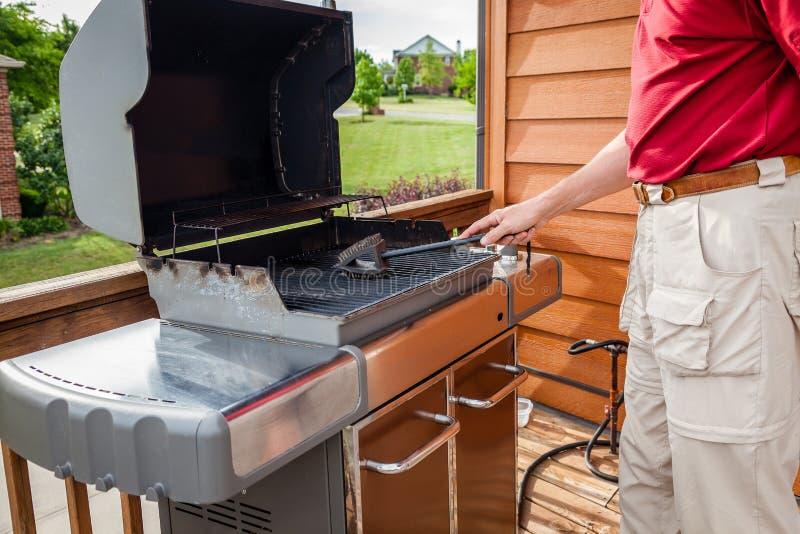 Schoonmakende grill stock afbeeldingen