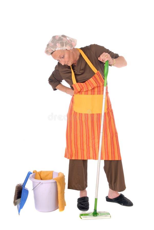 Schoonmakende huisvrouw stock afbeeldingen