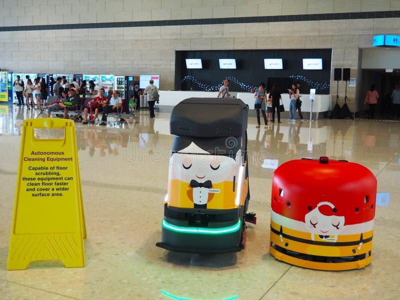 Schoonmakende Robots bij Changi Luchthaventerminal 4, Singapore royalty-vrije stock afbeeldingen