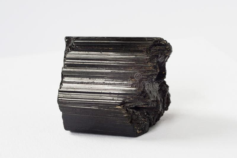 Schorl mineral also black tourmaline on white background stock images