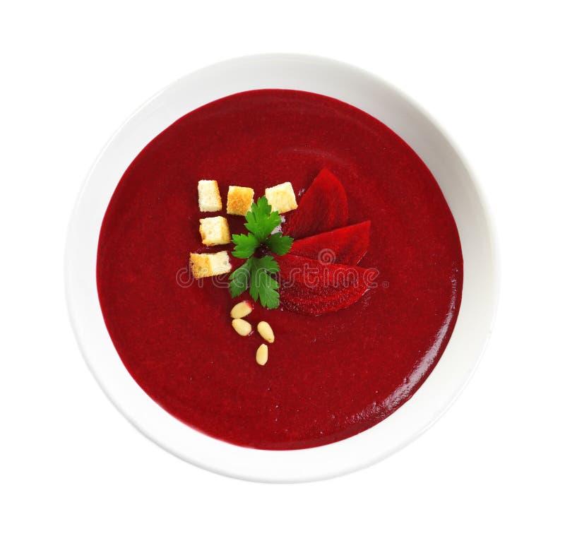 Schotel met de soep van de bietenroom op witte, hoogste mening Gezond voedsel royalty-vrije stock foto's