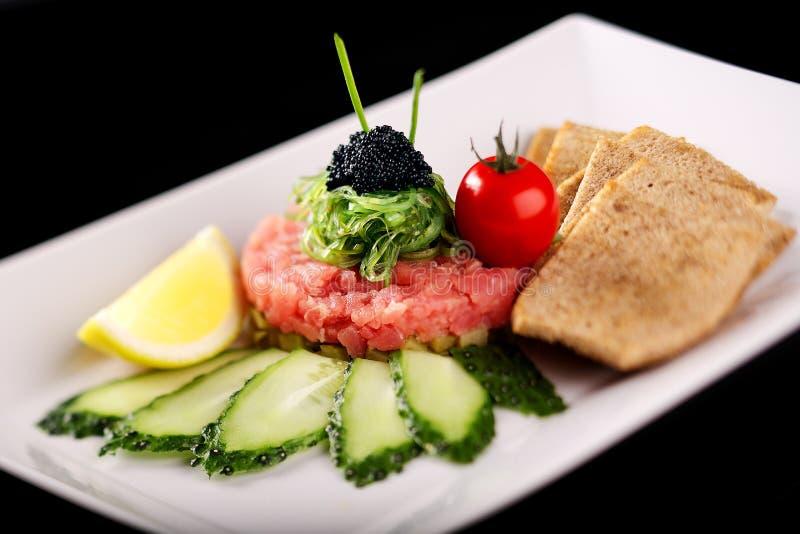 Schoteltandsteen met tonijn stock afbeeldingen