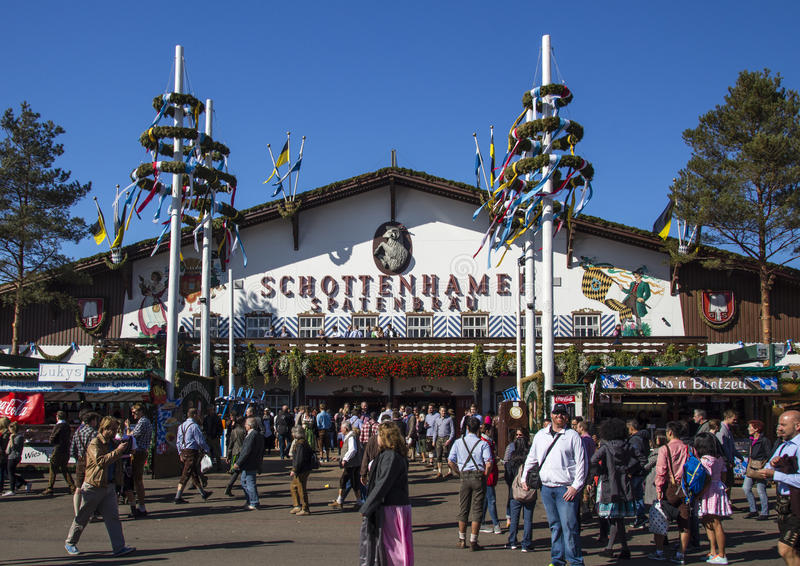 Schottenhamel tent at Oktoberfest in Munich, Germany, 2015. Facade and entrance of the Schottenhamel beer tent with people standing in front royalty free stock photos