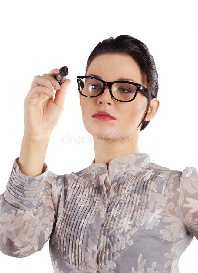 Schreiben der eleganten Frau lizenzfreie stockfotografie