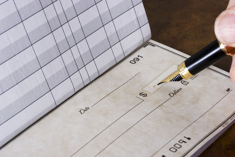 Schreiben des Checks stockfotografie