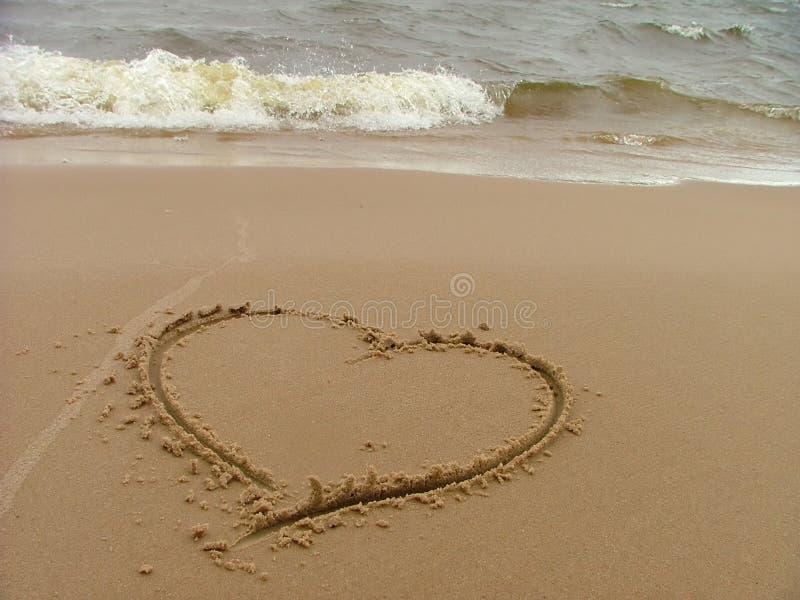 Schreiben am Strand lizenzfreie stockfotos