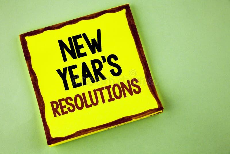Schreibensanmerkung, die neues Jahr \ 's-Beschlüsse zeigt Geschäftsfoto visiert Präsentationsziel-Ziele Entscheidungen für den fo lizenzfreies stockfoto
