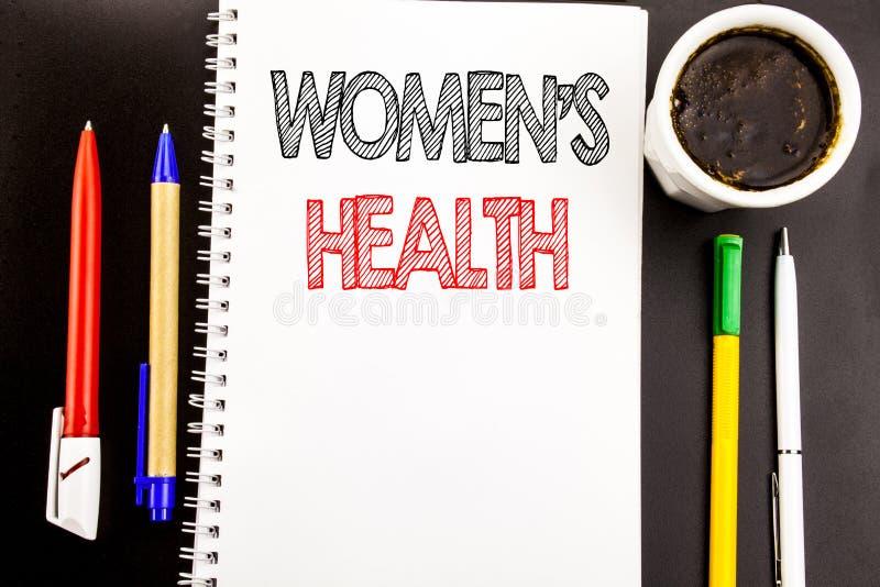 Schreibenstext, der Frauen s-Gesundheit zeigt Geschäftskonzept für die weibliche Feier geschrieben auf Notizblockbriefpapierhinte stockfotos