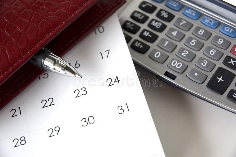 Schreiberspitze auf Kalender stockbild