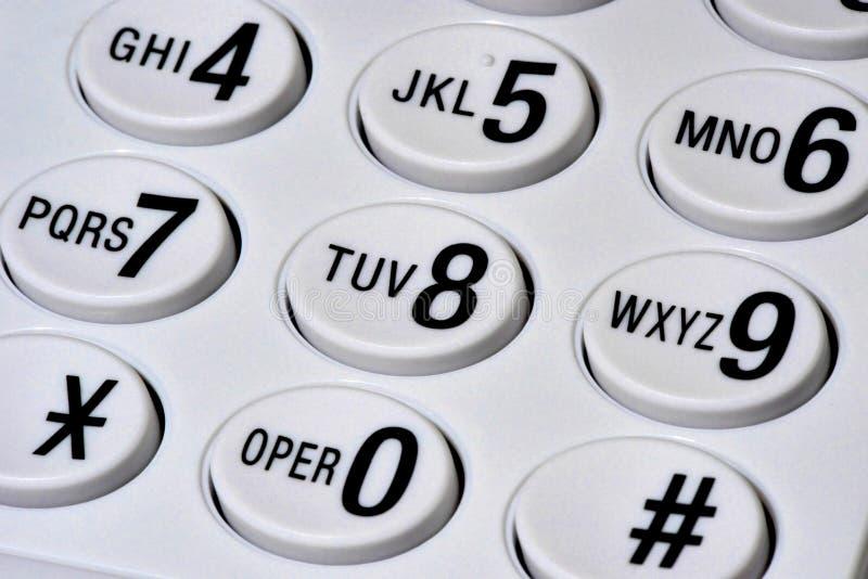 Schreibtischtelefonschlüssel-Auflagennahaufnahme lizenzfreies stockfoto