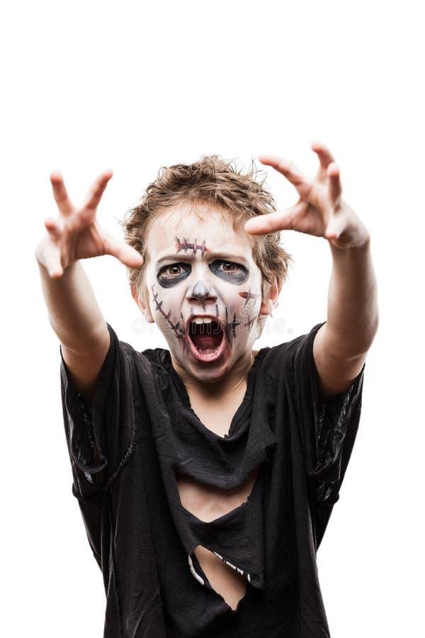Schreiendes gehendes totes Zombiekinderjungenhalloween-Horrorkostüm stockfoto