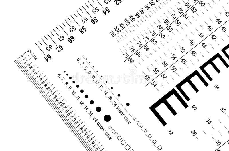 Schriftgröße-Messgeräte und Machthaber stockfoto