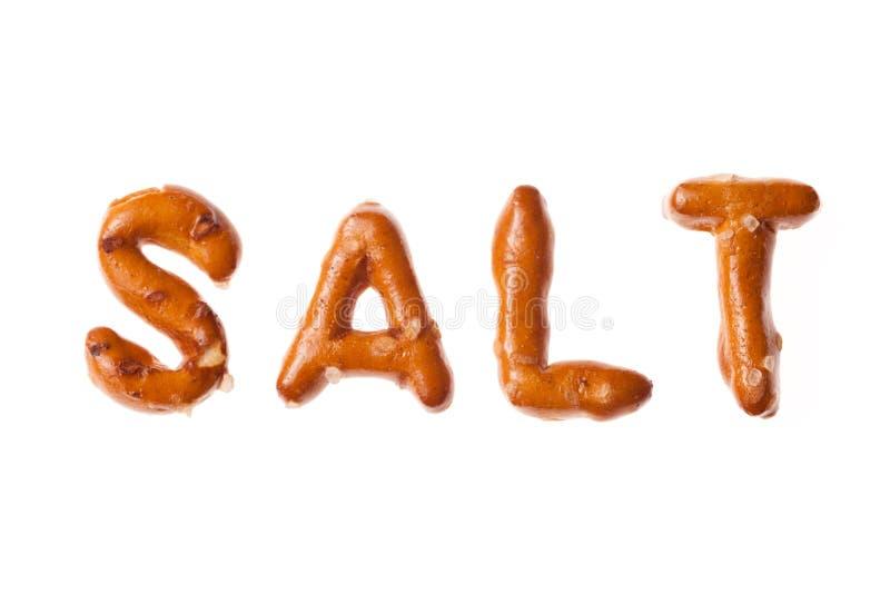 Schriftliches Wort SALZ der Alphabetbrezel lokalisiert lizenzfreies stockfoto