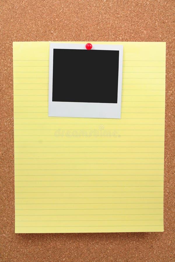 Schrijfpapier en lege foto royalty-vrije stock foto