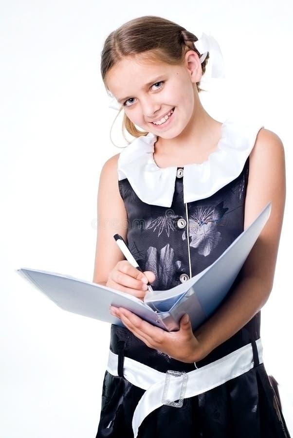 Schrijvend schoolmeisje royalty-vrije stock afbeeldingen