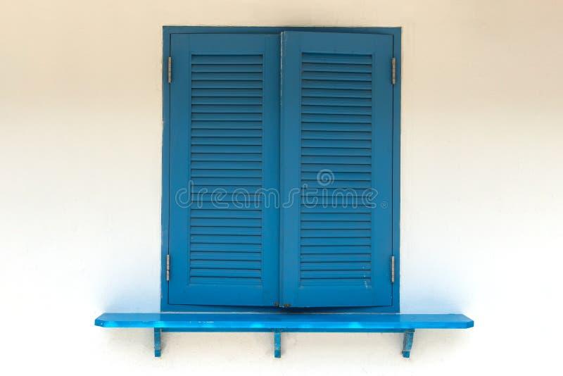 Schrijver uit de klassieke oudheid van het close-up is de Blauwe venster dicht en muur stock afbeeldingen