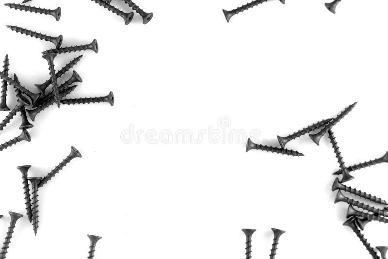 Schroeven op een witte achtergrond stock foto