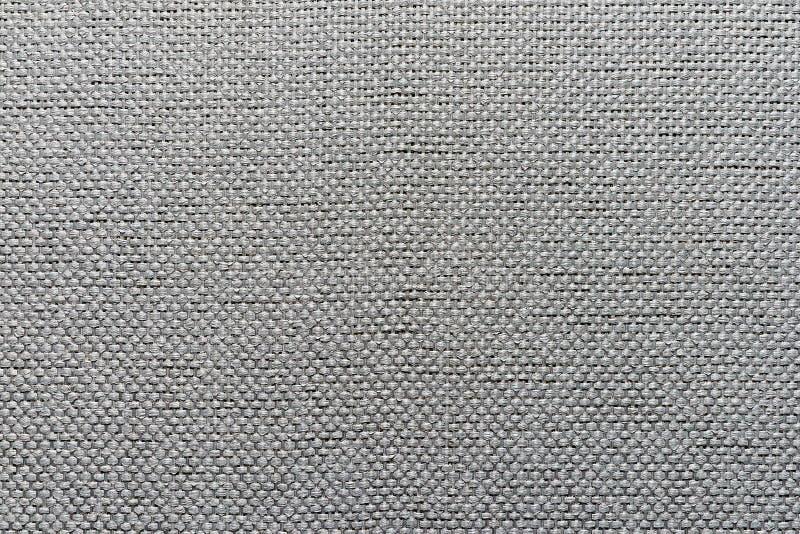 Schroffer Textilgrauhintergrund lizenzfreie stockfotografie