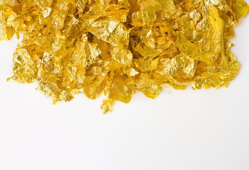 Schrotte der Goldfolie stockbilder