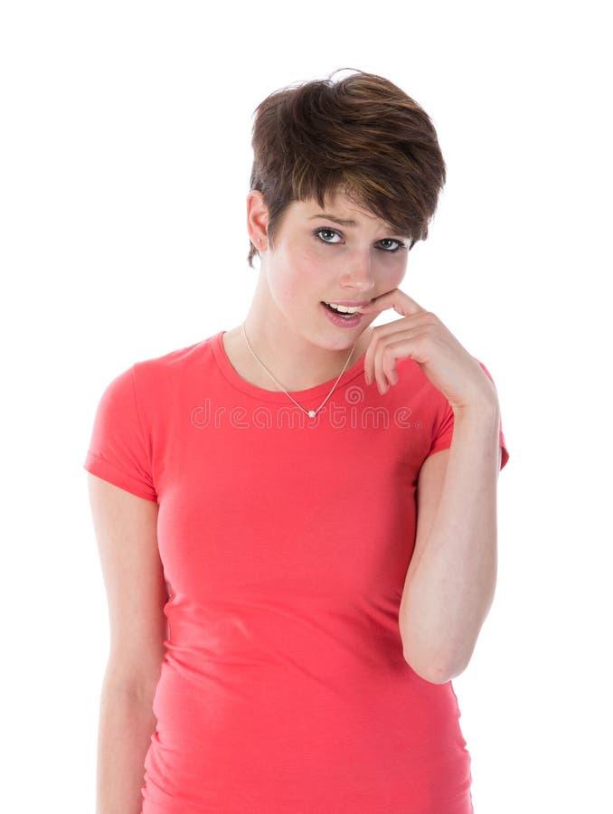 Schuchter meisje met vinger in haar mond stock foto