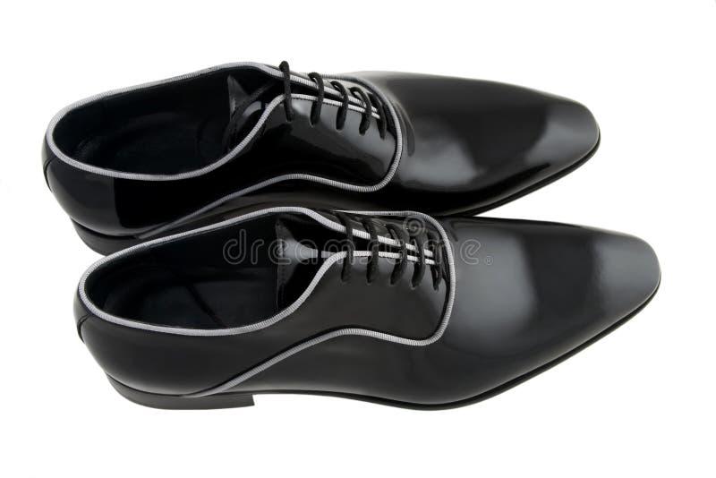 Schuhe des schwarzen Mannes stockbild
