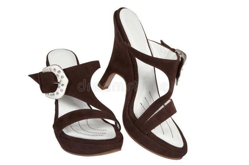 Schuhe vom braunen Veloursleder stockbild