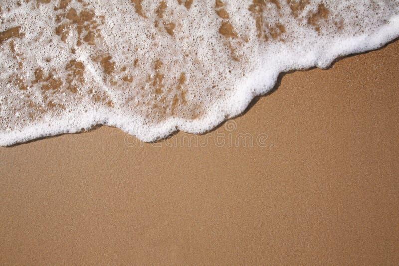 Schuim op zand royalty-vrije stock foto's