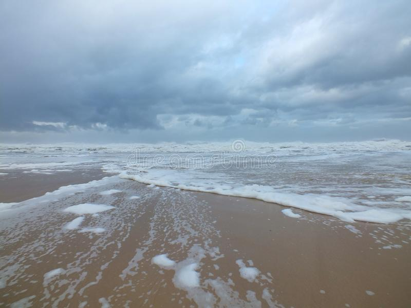 Schuimend Strand stock foto