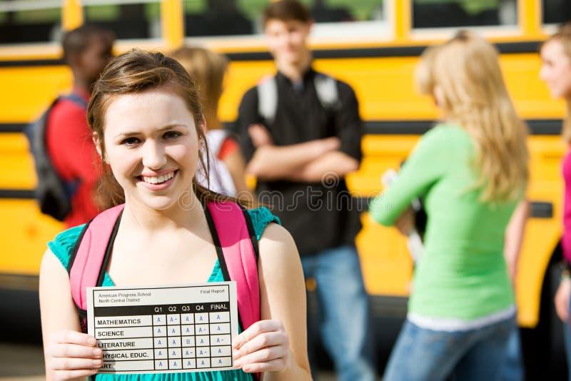 Schulbus: Studentin-Has Great Report-Karte lizenzfreie stockbilder
