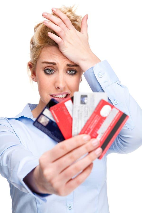 Schuld-Probleme betonten Frauen-Holding-Kreditkarten lizenzfreies stockfoto