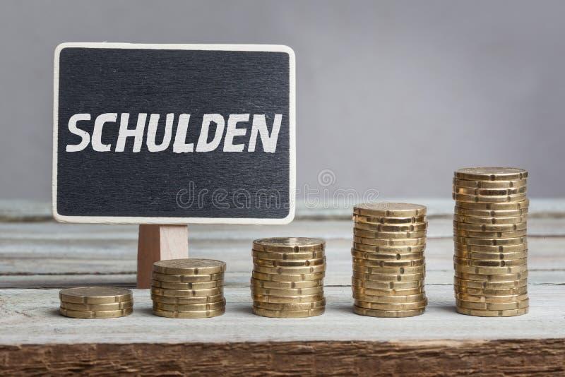 Schulden (Schulden) in der deutschen Sprache lizenzfreie stockfotografie