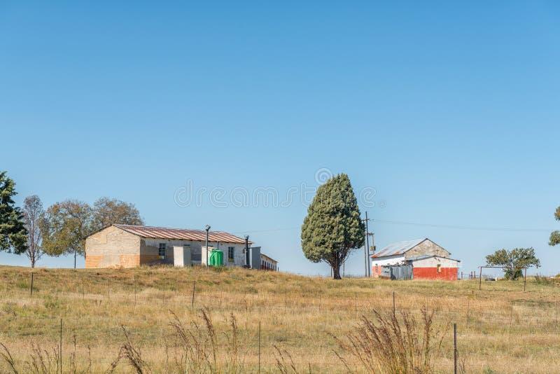 Schule auf einem Bauernhof zwischen Wärter und Vrede stockbild