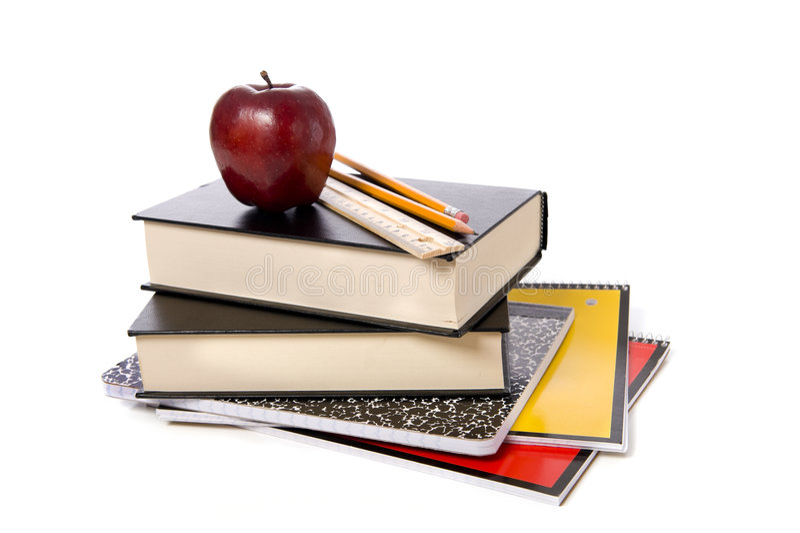 Schule-Bücher mit Apple lizenzfreie stockbilder