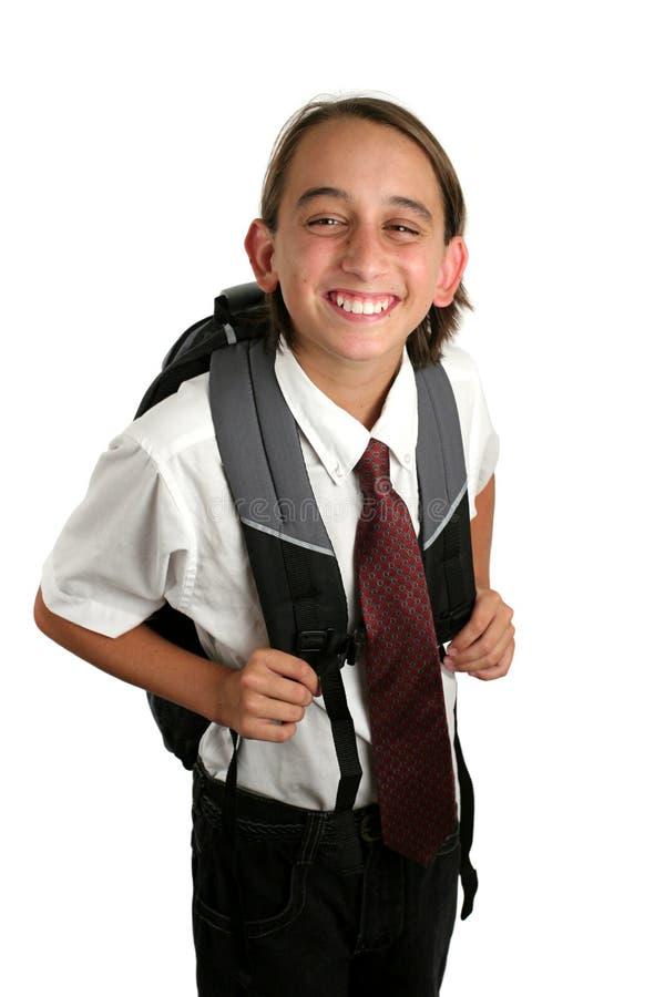 Schule-Jungen-Grinsen stockbild