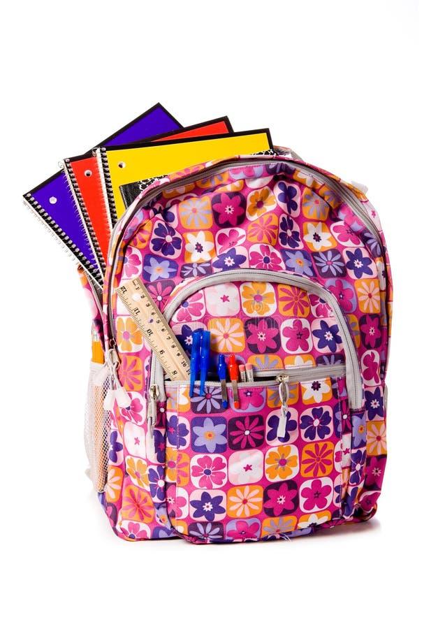 Schule-Rucksack, der mit Zubehör überläuft lizenzfreie stockbilder
