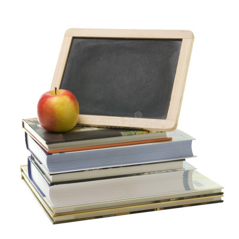 Schulebücher und -apfel lizenzfreies stockbild