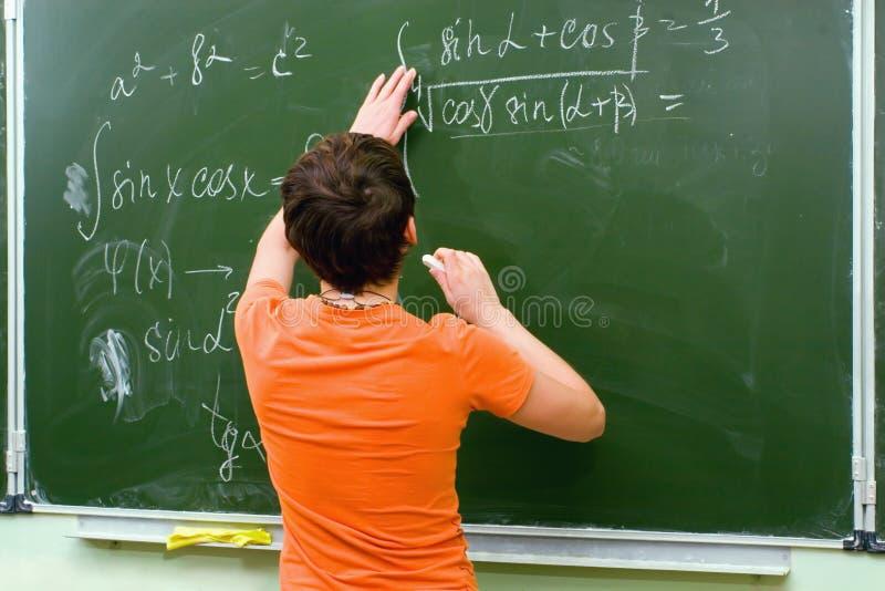 Schulmädchen. Lektion stockfotos