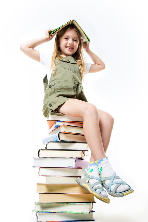 Schulmädchen mit Büchern lizenzfreies stockbild