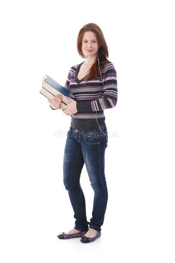 Schulmädchen mit Büchern und Kopfhörer stockbilder