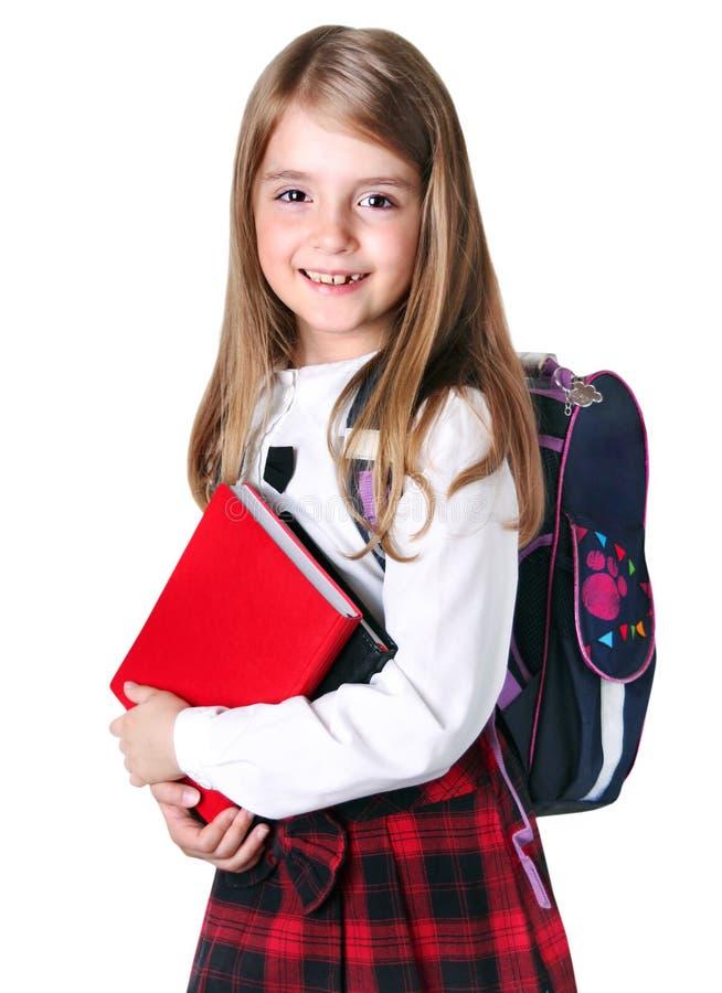 Schulmädchenkind lokalisiert auf Weiß stockfoto