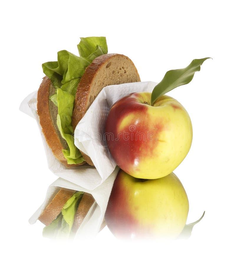 Schulmahlzeitapfel und -sandwich stockfoto