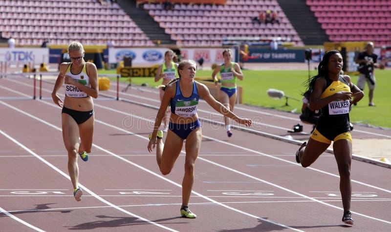 SCHULZ de Sylvia, o CAMINHANTE de Brooke JAWORSKI e de Sanique que corre obstáculos de 400 medidores aquecem-se no campeonato do  imagem de stock