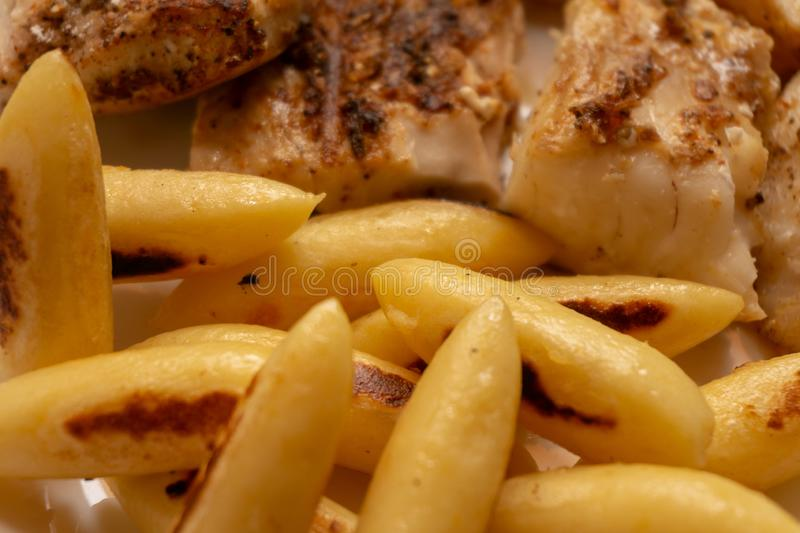 Schupfnudeln, German speciality from formed potato dough, with panfish royalty free stock image