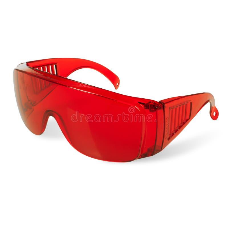 SCHUTZzahnheilkundelaser-Enthaarungszahnweißung der schützenden roten Gläser UV lizenzfreie stockfotos