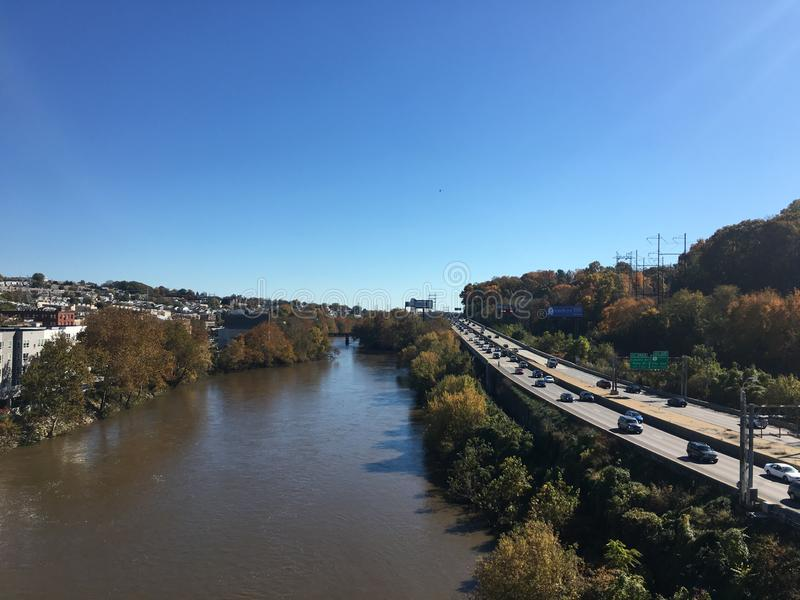 Schuylkill River and Schuylkill Expressway. In Pennsylvania on a fall day with blue stock photos