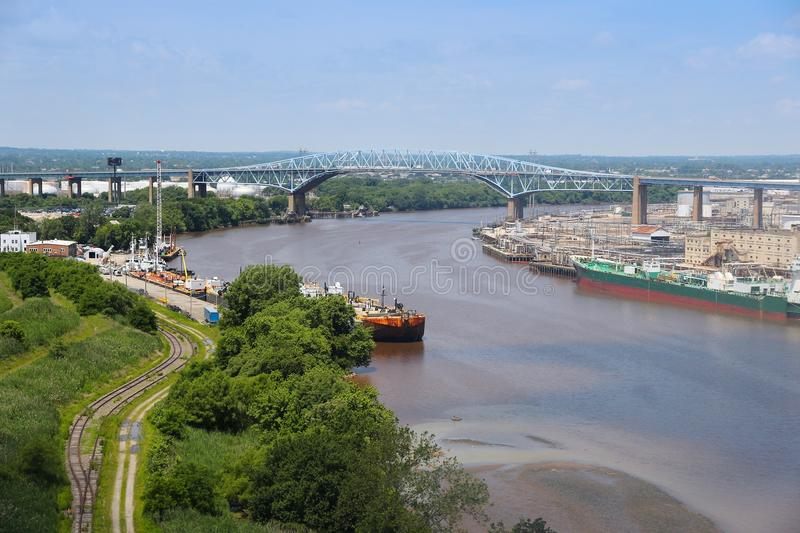 Schuylkill River. Philadelphia, Pennsylvania, United States - Schuylkill River with Platt Bridge and industrial refinery royalty free stock photo