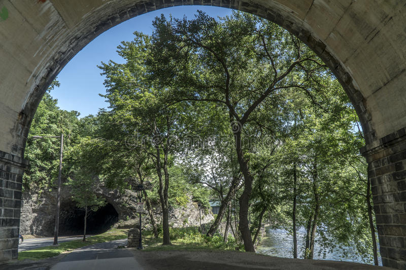 Schuylkill river trail. Picture of from below rail bridge on the Schuylkill river trail close by rock tunnel bend stock photo
