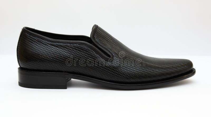 Schwärzen Sie männliche Schuhe stockfotografie