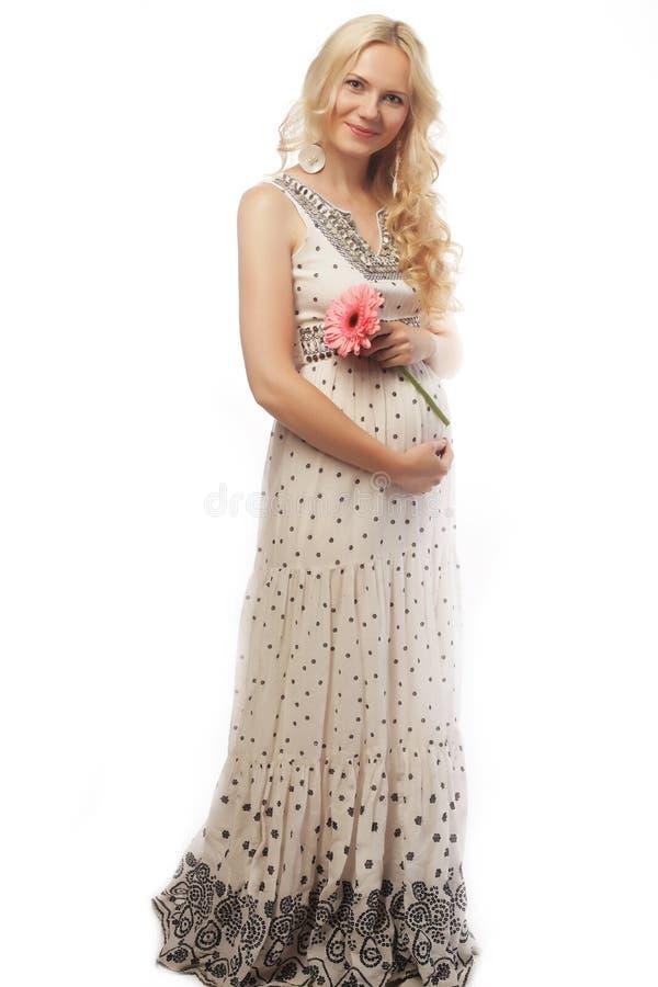 Schwangere Frau der Junge mit gerber lizenzfreies stockfoto